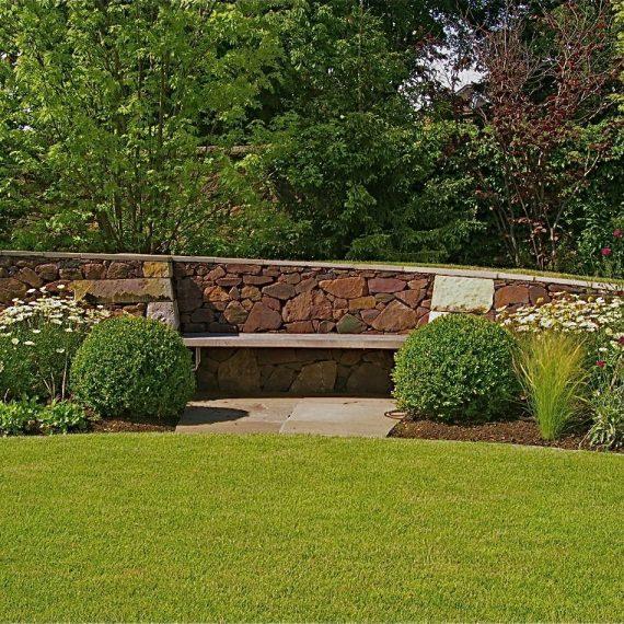 Oak bench built into Serpentine wall, designed by Carolyn Grohmann