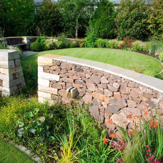 Serpentine garden curving wall, designed by Carolyn Grohmann