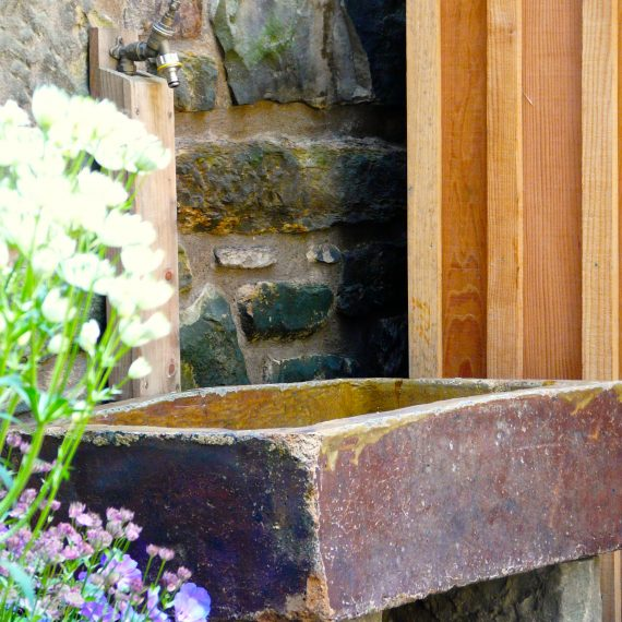 Stone sink, Eton Terrace Garden designed by Carolyn Grohmann