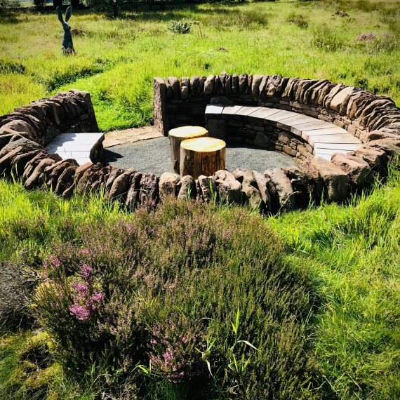 The 'Sheep Pen' seating area made with local stone and Scottish larch bench. Designed by Carolyn Grohmann