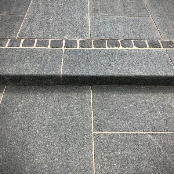 Black basalt paving and black basalt setts. Designed by Carolyn Grohmann.