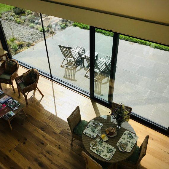View from mezzanine level of patio. Garden designed by Carolyn Grohmann