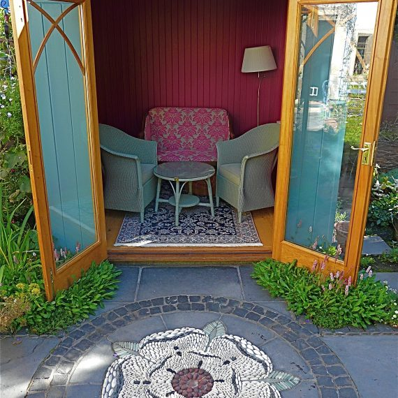 Kate Atkinson's writing den and mosaic, designed by Carolyn Grohmann