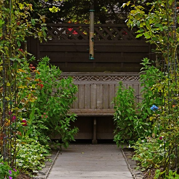 Oak pew, Kate Atkinson's garden, designed by Carolyn Grohmann