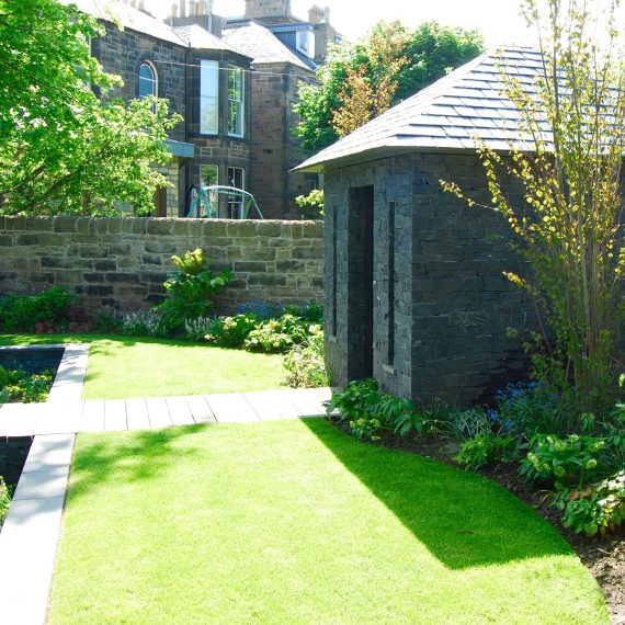 Slate and stone garden building, designed by Carolyn Grohmann
