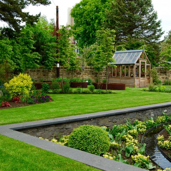 Sunken garden, rill water feature, Gabriel Ash greenhouse, garden designed by Carolyn Grohmann