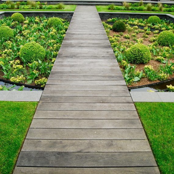 Scorched oak boardwalk over sunken garden designed by Carolyn Grohmann