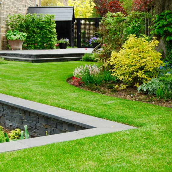 Sunken garden, lawns, and planted borders, designed by Carolyn Grohmann