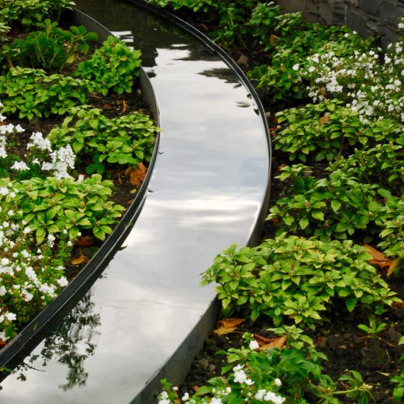 Metal rill water feature designed by Carolyn Grohmann