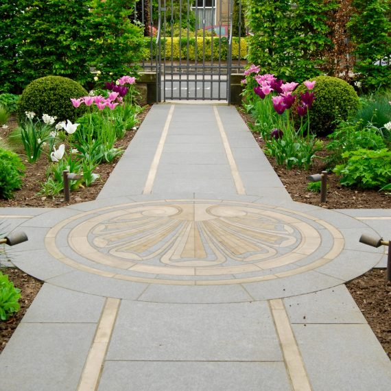 Black basalt paving with Clashach inlay and cut stone mosaic by Joel Baker. Garden designed by Carolyn Grohmann