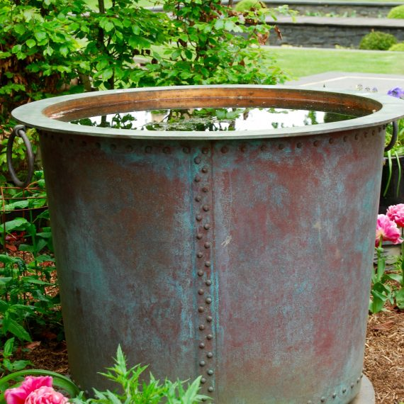 Copper tub water feature made by Ratho Byres Forge, designed by Carolyn Grohmann