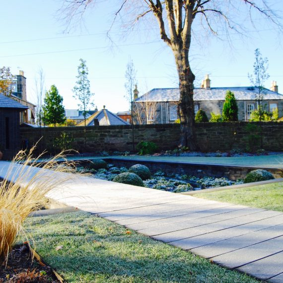 Frosted sunken garden and scorched oak boardwalk, designed by Carolyn Grohmann