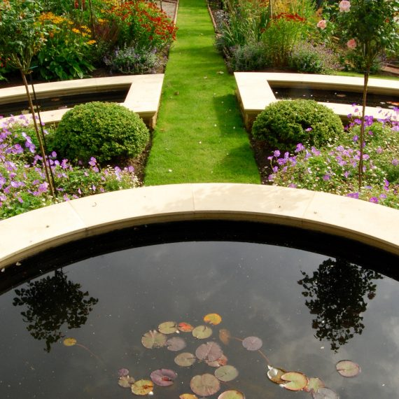 Formal raised water feature designed by Carolyn Grohmann