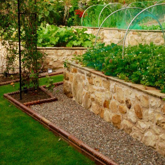 Raised stone vegetable beds, designed by Carolyn Grohmann