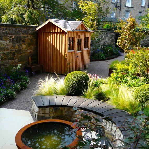 Urbis lily bowl, scorched oak bench, garden designed by Carolyn Grohmann